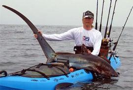 getting a fish while kayaking