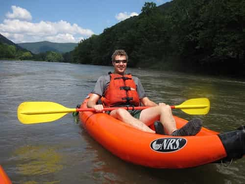guy in an inflatable kayak