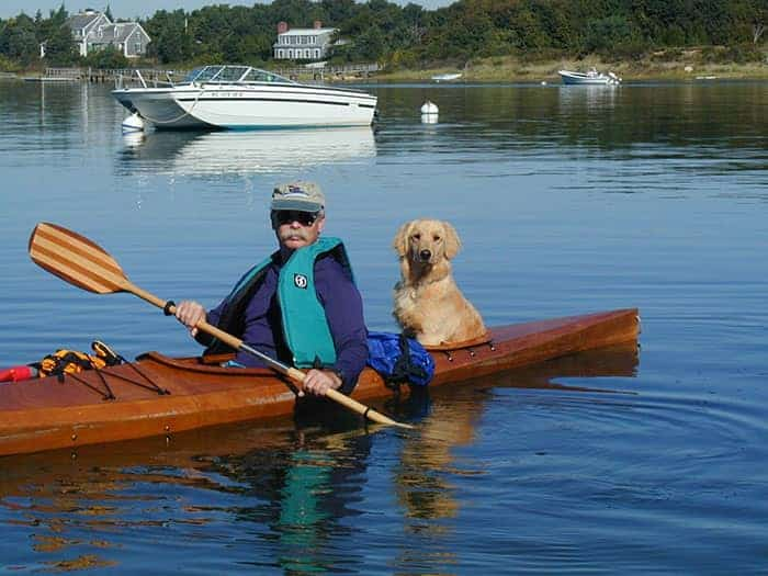 guy kayaking with his dog