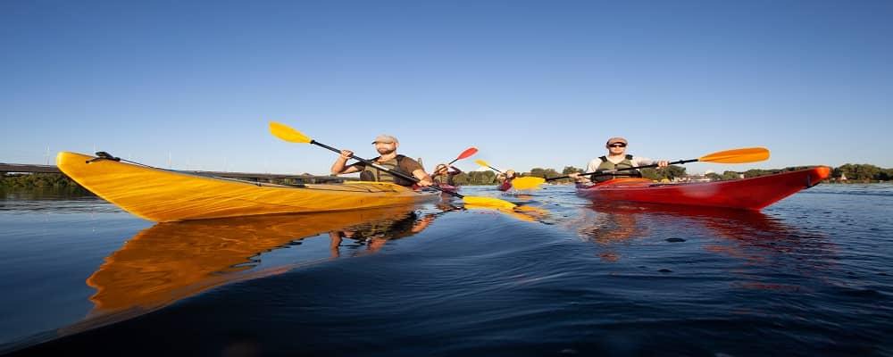 People paddling a kayak