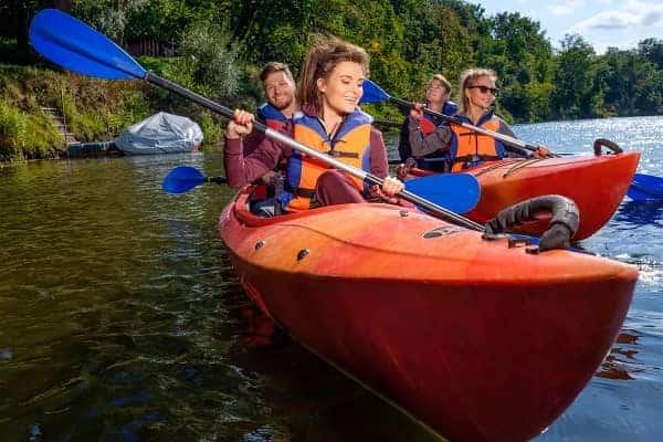 best friends having fun on a kayaks