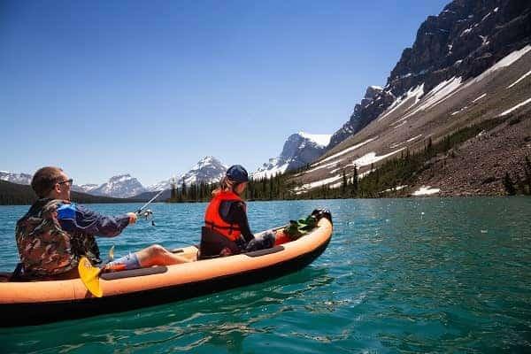 Couple fishing on an inflatable kayak
