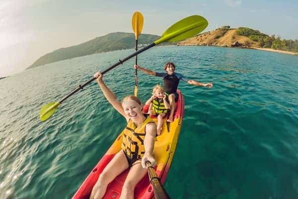 happy family with baby kayaking