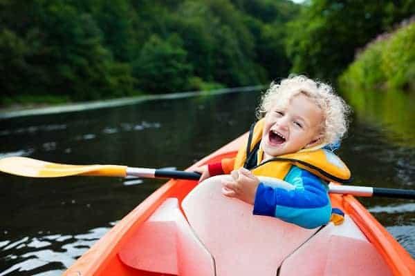 kid enjoying kayak ride